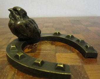 Antique bronze statue bird on horseshoe, cute little bronze