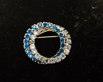 Classic double circle eternity pin with blue and clear stones