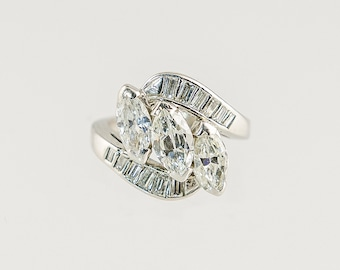 Simply beautiful 1960's era three stone diamond ring set in platinum
