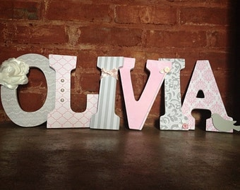 Wooden decorative letters. Gray and pink nursery name.