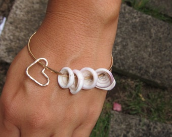 Hammered Bangle with Puka Shells and a Heart Charm