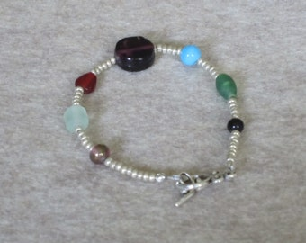 Silver colored glass bead bracelet