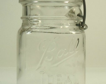 ball ideal mason jar. ball ideal pint size canning jar with glass lid and wire bail circa 1933 - 1960 mason