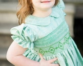 Girls custom HALF smocked bodice, silk dress with peter pan collar & ruffle trimmed sleeves. Free matching bow. Color of your choice.