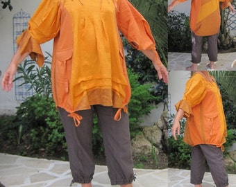 Tunic size 44 made from fabrics of various colours in shades of orange.