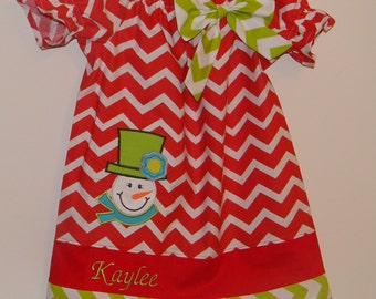 Christmas dress peasant style in red chevron with red and green trim and snowman on the skirt .