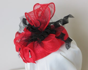 Red Sinamay Fascinator with red and black Sinamay embellishments