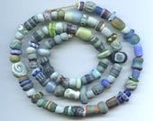 strand of artisan handmade ceramic clay and glass beads, blue -green -aqua
