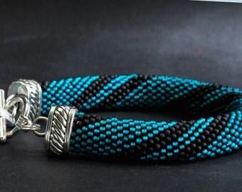 Seed bead rope bracelet in matte teal and black