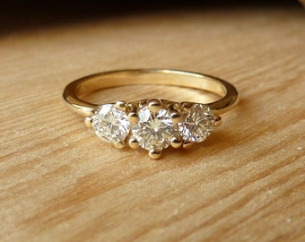 Three Stone Prong Set Diamond Ring