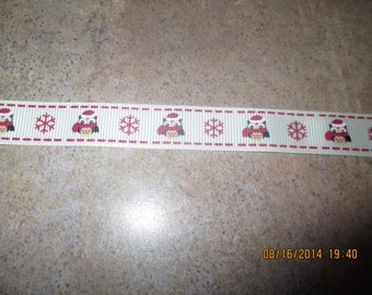 Beige ribbon with puppies and snowflakes.