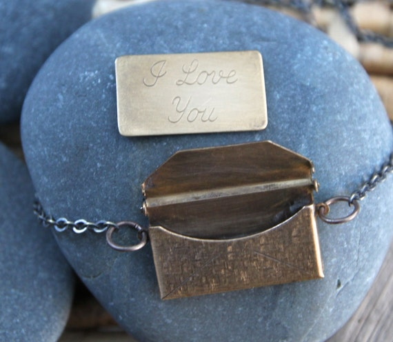i love you . a postcard and envelope necklace