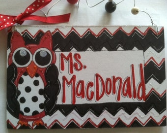 Hand personalized red and back owl sign