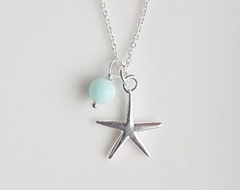 Sterling silver starfish necklace with pale blue stone charm