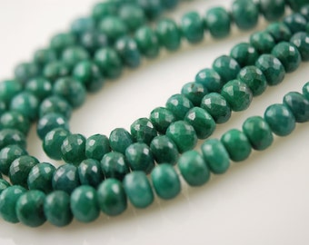 Faceted emerald roundels