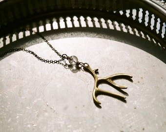 Antler amulet  - bohemian necklace with antique bronze antler pendant and rock crystal orb bead.