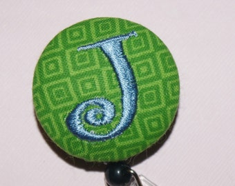 Id Reel monogrammed, U design, fabric, letter and color.