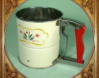 1940s Hand-i-Sift flour sifter with floral print.