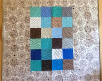Center Blocks Quilt in Blues, Greens, Browns and other colors