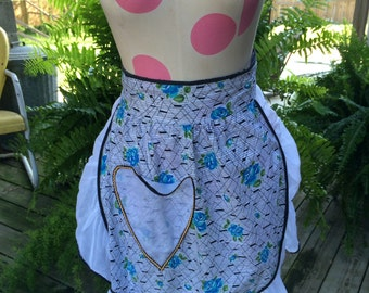 Vintage White Organdy and Blue Rose Print Cotton Half Apron with Black Piping Trim and Yellow Rick Rack Trim on Pocket