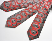 Hand printed Silk Necktie in warm gray silk with hexagon print in orange, black, and silver, each is original and one of a kind