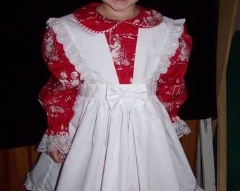 Girls apron pinafore with eyelet ruffles.  Size 2 to 8