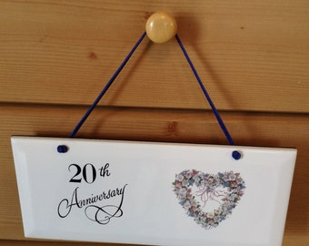 20 Anniversay Ceramic Plaque  it is 4 1/4 by 10