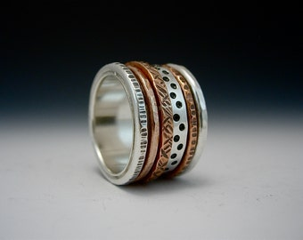 Kinetic Series - Esprit.  Sterling Silver, Bronze, and Copper Spinner Ring