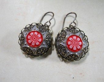 Ornate Molded Glass Vintage Cabochon Earrings with Hand Painted Detail in Black and Red on White Glass Made in West Germany