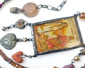 A Love Song. Assemblage art necklace with gemstones and matchbook label.