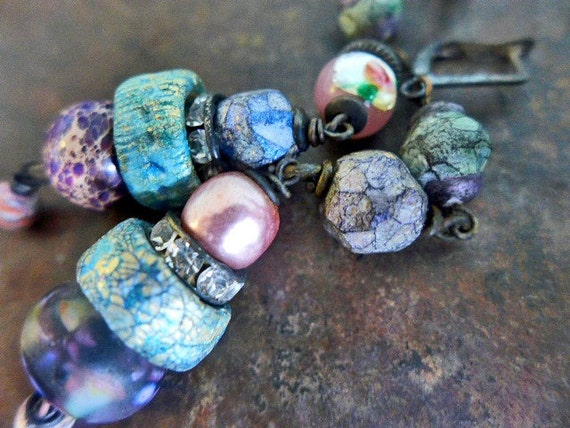 The Enchantress. Rustic asymmetric assemblage earrings with polymer art beads in pastels.
