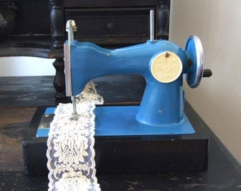 Vintage sewing machine in blue, Soviet Union era c.1970 sewing machine, toy sewing machine in working condition, childrens toy