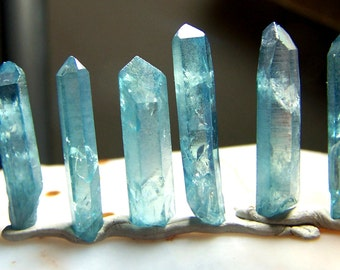 ONE Aqua aura crystal 1 -1 1/4  inches long - selected at random Quartz Crystal point treated with Gold molecules - medium coyoterainbow JX