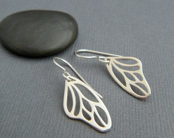 silver butterfly wing earrings. simple nature jewelry. small sterling silver dangle. modern wing. drop earrings. gardener gift for her.
