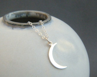 small crescent moon necklace. sterling silver moon sliver charm. tiny celestial astrology delicate dainty pendant. simple everyday jewelry