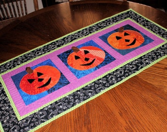 Pumpkins Table Runner or Wall Hanging in Black, Orange and Purple, - an Autumn, Fall and Halloween Quilted Table Runner