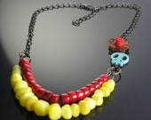 Day of the Dead Necklace. Turquoise skull with red rose and coral beads..