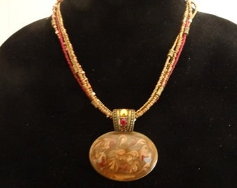 "CHICOS signed Vintage gold tone 20"" necklace with 4 red and gold seed beaded strands and 2"" enamelled pendant in great condition"