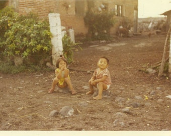 Mexican Children Playing Outside Sister Brother Sitting on Rocks Mexico Vintage Color Photo Photograph