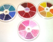 4 Packs of Various Colored Glass Seed Beads