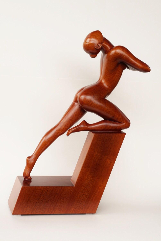 Nude woman wood sculpture OUTBURST