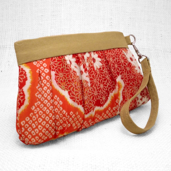 Zippered clutch made from a vintage Japanese cotton kimono in beautiful orange and gold with white flowers