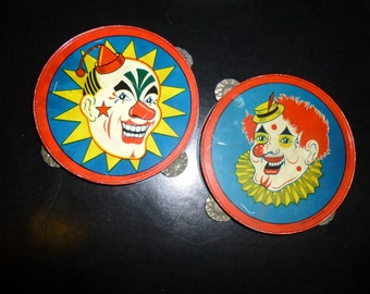 The Tambourine Player is Such a Clown.  Two 1950s Vintage Tin Litho Toy Tambourines. T Cohn Brooklyn, NY.