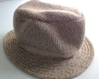Knit wool blend hat. Looks like the knitted wool socks.  Beige.  Color of the Sock Monkey