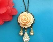Peach cream rose with three clear stone dangle necklace antique bronze chain