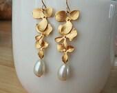three gold  lotus with teardrop pearl earring