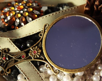 Pretty dainty vintage handheld mirror with embellishments