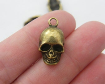 4 Skull charms antique bronze tone BC89