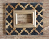 5x7 Black Quatrefoil on raw stained wood with Gold Colonial Trim