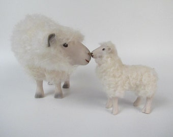 Cotswold Ewe Bending Down, Nose to Nose with Medium Lamb